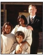 Rabbit-Proof Fence movie still: Tianna Sansbury as Daisy, Laura Mongahan as Gracie, Everlyn Sampi as Molly and Kenneth Branagh as Mr. Neville in Rabbit-Proof Fence