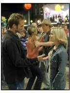 Sweet Home Alabama movie still: Melanie Carmichael (Reese Witherspoon, right) finds herself falling for her highschool sweetheart--and husband, Jake (Josh Lucas, left) all over again.