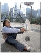 Like Mike movie still: Calvin (Lil Bow Wow) tries on an old pair of sneakers--which turn out to have some special powers