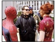 Spider-Man movie still: Sam Raimi with Tobey Maguire and Kirsten Dunst on the set of Spider-Man