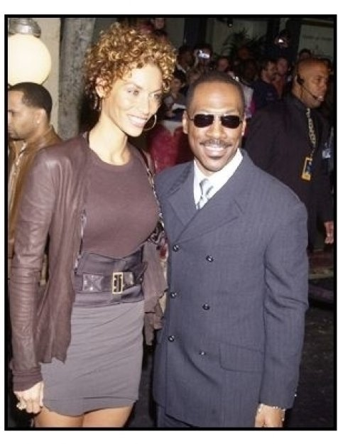 "Eddie Murphy with wife Nicole at ""The Haunted Mansion"" Premiere"